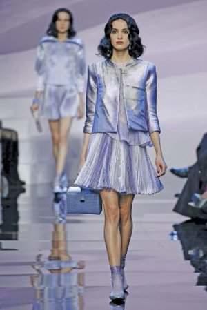 A model presents a creation by Italian designer Giorgio Armani as part of his Haute Couture Spring/Summer 2016 fashion show for Giorgio Armani Prive in Paris