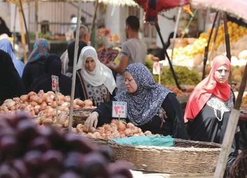 Egyptians shop at a vegetable market in Cairo